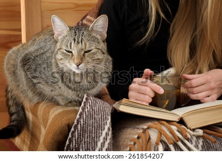 rest at home with book, tea and cat