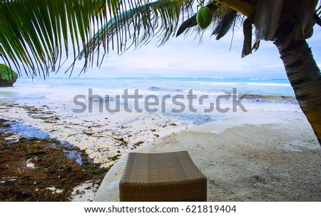 Rest in a chaise lounge in a luxurious oceanfront beach in Kenya\n