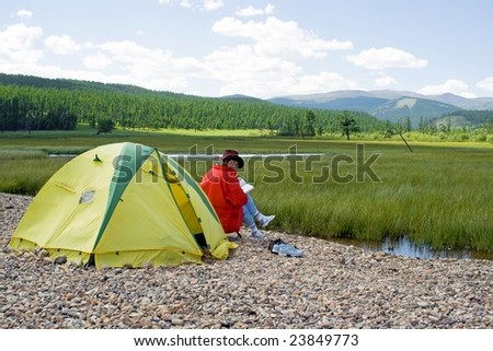 Rest on the bank of lake - stock photo