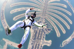 Rest tourism Jumeirah palm. Travel skydiver flying over the Islands. Beautiful views of Dubai city.