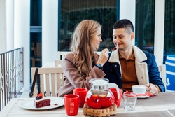restaurant. a guy with a girl drink hot coffee and tea