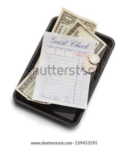 Restaurant bill with money on payment tray isolated on a white background.