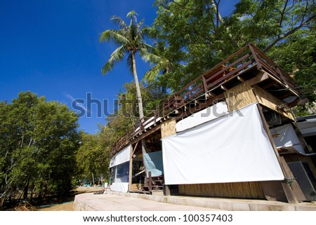restaurant building, one building stand alone on shore in clear blue sky