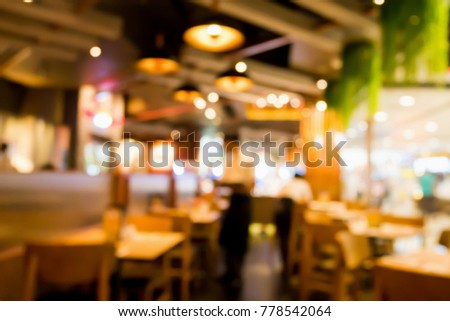Restaurant cafe interior abstract blur background with bokeh light #778542064