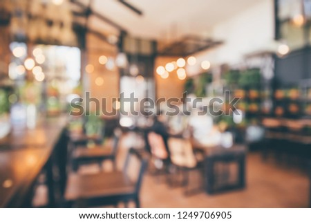 Restaurant cafe or coffee shop interior with customer blur abstract vintage style bokeh light for montage product display background #1249706905