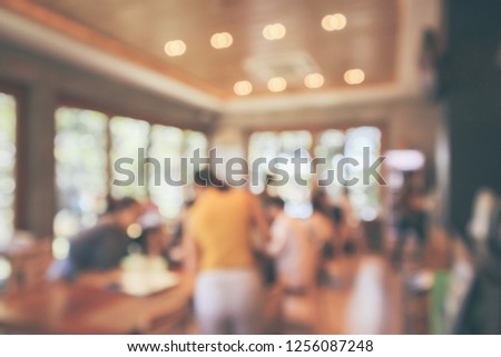 Restaurant cafe or coffee shop interior with customer blur abstract vintage style bokeh light for montage product display background #1256087248