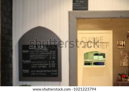 Restaurant chef captured through kitchen door window.
