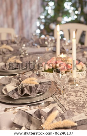 Restaurant christmas table with fancy folded napkins