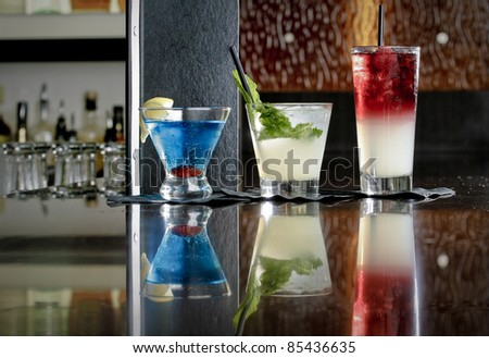Restaurant Cocktails Lined up on a Marble Bar Top