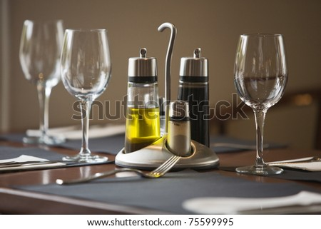 Restaurant dining table, set and ready - stock photo
