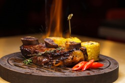Restaurant dish. Fried ribs of marbled beef served with a twinkle