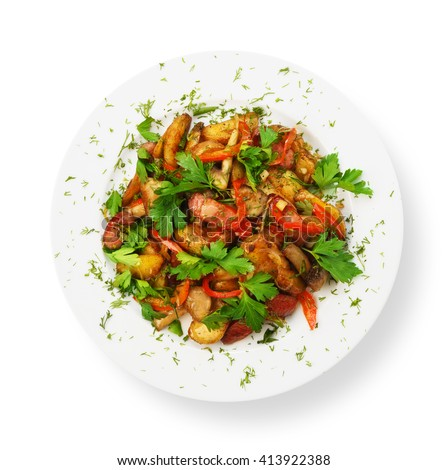 Restaurant food - roasted potatoes with vegetables and mushrooms, parsley isolated at white background. Top view. #413922388