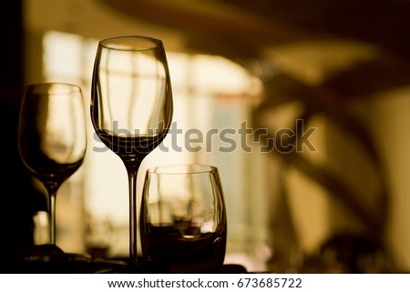 restaurant glass of water on table / dish and spoon / dark tone  #673685722