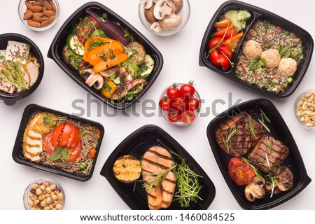 Restaurant healthy food delivery in take away boxes for daily nutrition on white background