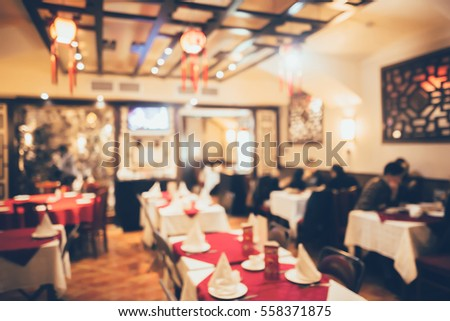 Restaurant in bokeh, defocused background #558371875