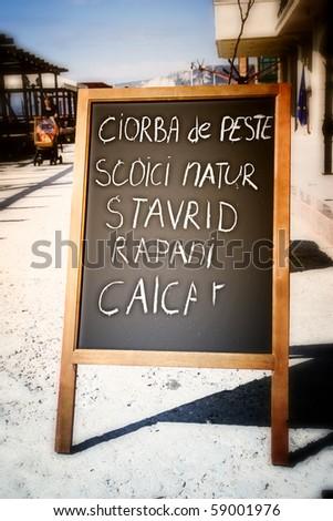 Restaurant menu chalkboard on the street