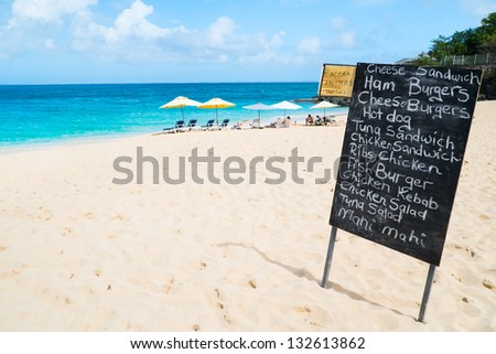 Restaurant menu on blackboard display at tropical beach