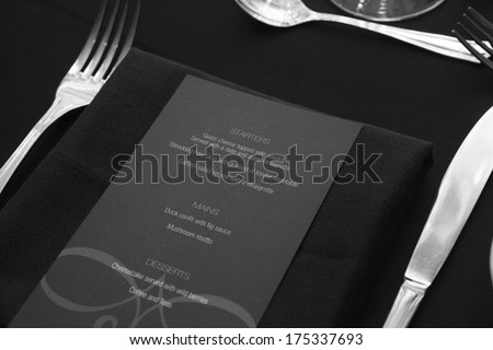 Restaurant menu on table for guests black and white