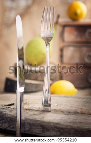 Restaurant menu series. Country place setting. Fork and knife in rustic country table setting. setting