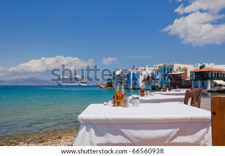 Restaurant near the sea at Little Venice on Mykonos Island and cruise liner