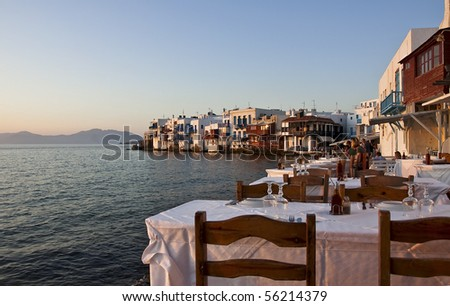 Restaurant near the sea at Little Venice on the island of Mykonos in Greece at sunset - very well-known