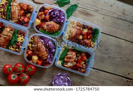 Restaurant offering takeout/delivery during the coronavirus pandemic. Prepared meals (meat, sauce, vegetables) in plastic containers. Ready-to-eat food from a certified home-kitchen, restaurant, cafe