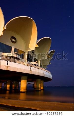 Restaurant on beach at night - stock photo