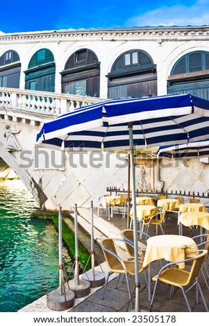 Restaurant on the bank of Grand Canal near Bridge Rialto, Venice, Italy