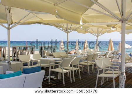 Restaurant on the beach in Greece  #360363770