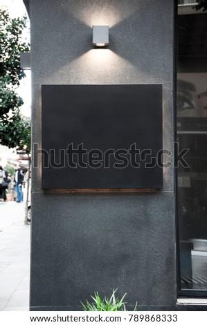 Restaurant or cafe sign for Mockup. Signboard in square form. Dark signboard.