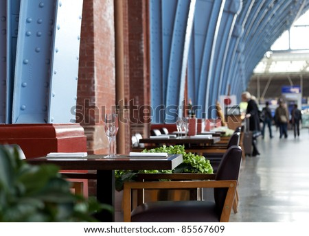Restaurant or cafe tables along the wall at english train station in London #85567609