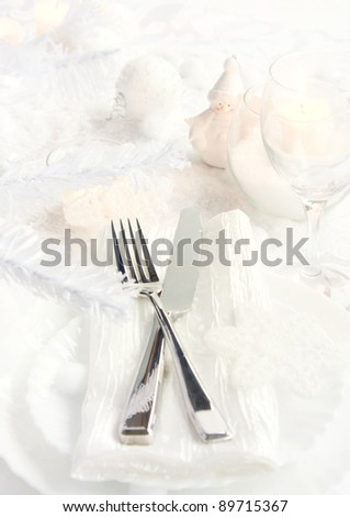 Restaurant series.Christmas dinner with table setting in white and holiday ornaments