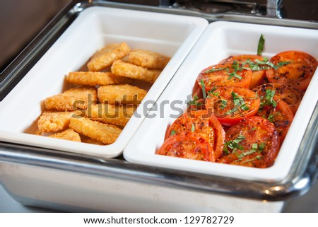 Restaurant serving of hash browns and baked tomato