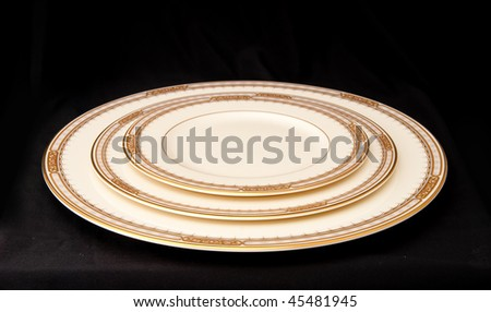 Restaurant Serving Plate, Dessert Plate and Sauce Plate Stacked on Black