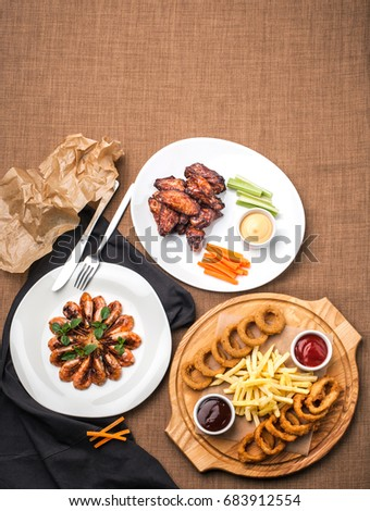 Restaurant still-life with plates with food on a table background, top angle. Template for a menu. Template for a menu #683912554