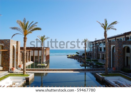 Restaurant, swimming pool and beach of luxury hotel, Crete, Greece