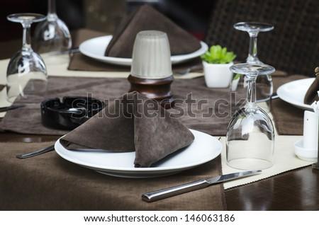 Restaurant table served for dinner