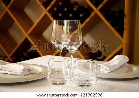 Restaurant table with dish, glasses and cutlery