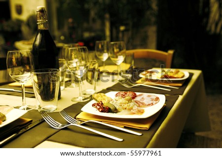 Restaurant table with dishes full of food