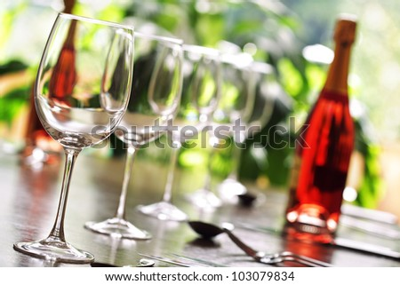 Restaurant table with silverware, wine and wine glasses