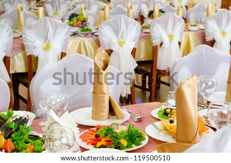 restaurant tables laid for a wedding banquet