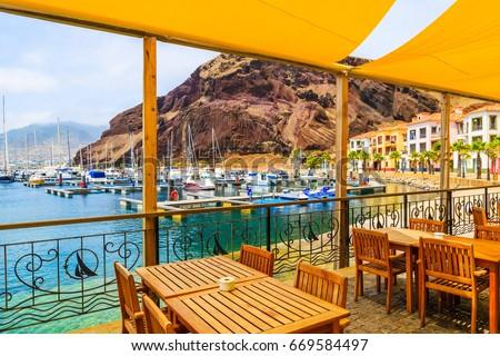 Restaurant terrace in sailing port on coast of Madeira island, Portugal