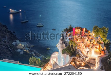 Restaurant terrace over the ocean at night. Luxury and holiday concept.