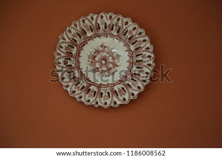 Restaurante Central do Bom Jesus,brown white ceramic traditional national plate with text and flower pattern hanging on the wall #1186008562