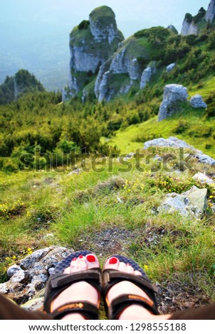 Resting feet, hiking in the mountains, Ceahlau Mountains, Romania #1298555188