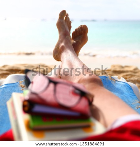 Resting feet in the summer at the beach #1351864691