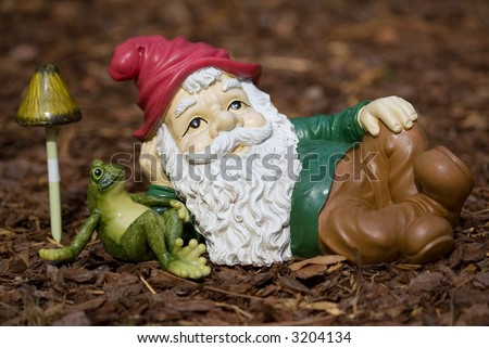 Resting garden gnome - stock photo