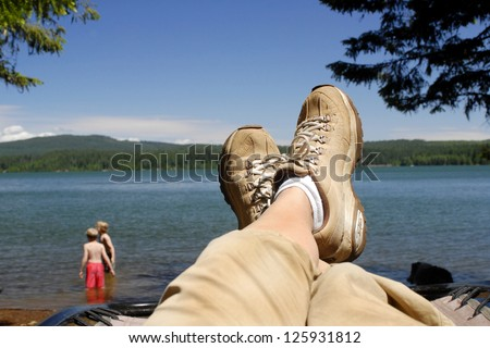 Resting on the side of a lake after hiking all day