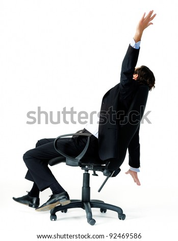 Restless office worker turns in his seat and throws his arms in the air