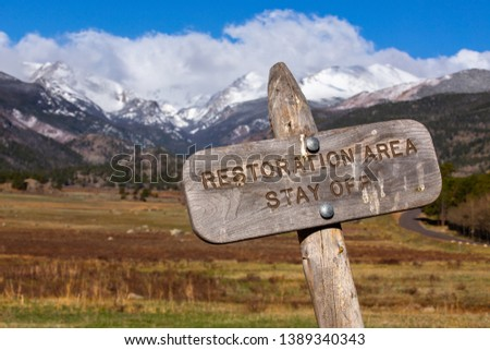 Restoration area sign on national park government protected lands, federal land, mountain and field landscape  #1389340343